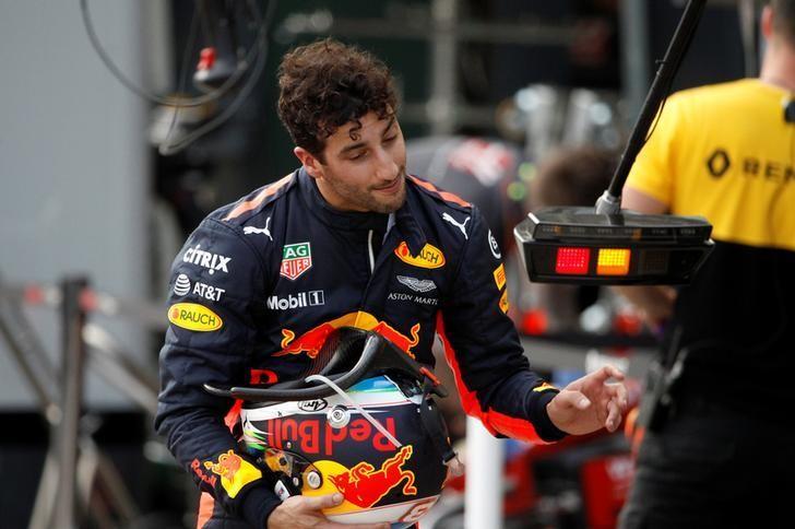 Formula One - F1 - Australian Grand Prix - Melbourne, Australia - 25/03/2017 Red Bull Racing driver Daniel Ricciardo of Australia reacts as he walks down pit lane after crashing out of the qualifying session.  REUTERS/Brandon Malone