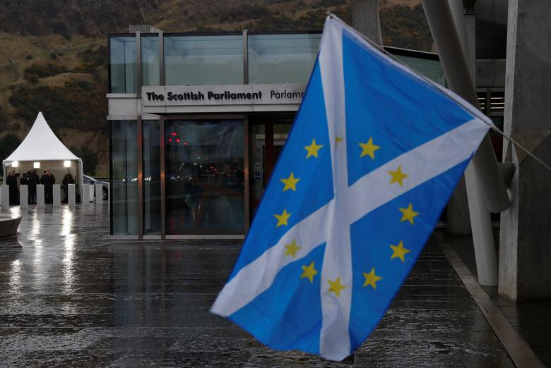 A Scottish Saltire flag flies outside the Scottish Parliament following suspension of the referendum debate in Edinburgh, Scotland, Britain March 22, 2017. REUTERS/Russell Cheyne