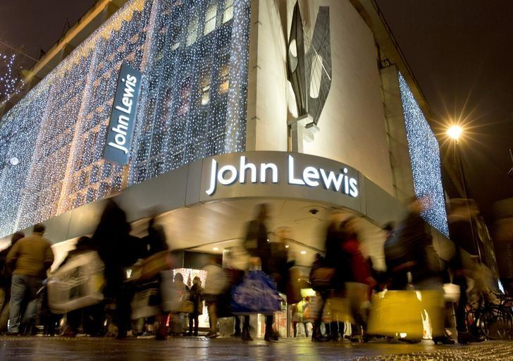 FILE PHOTO:  Pedestrians walk past a John Lewis store on Oxford Street, London, Britain, December 15, 2013.   REUTERS/Neil Hall/File Photo