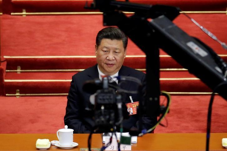 A camera is seen in front of China's President Xi Jinping as he attends the second plenary session of the National People's Congress (NPC) at the Great Hall of the People in Beijing, China March 8, 2017. REUTERS/Jason Lee