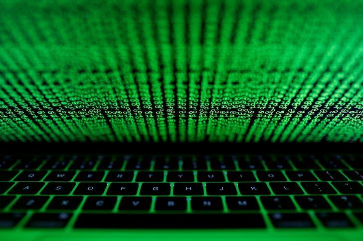 A computer keyboard lit by a displayed cyber code is seen in this illustration picture taken on March 1,  2017. REUTERS/Kacper Pempel/Illustration