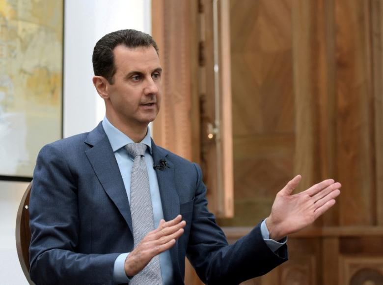 FILE PHOTO: Syria's President Bashar al-Assad speaks during an interview with Yahoo News in this handout picture provided by SANA on February 10, 2017, Syria.   SANA/Handout/File via REUTERS