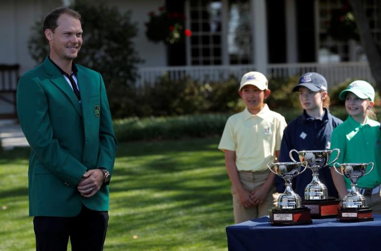 The 2016 Masters champion Danny Willett is gazed upon by young golfers as he waits to present trophies to the winners of the  Drive, Pitch and Putt National Finals at Augusta National Golf Course in Augusta, Georgia, U.S., April 2, 2017.  REUTERS/Brian Snyder