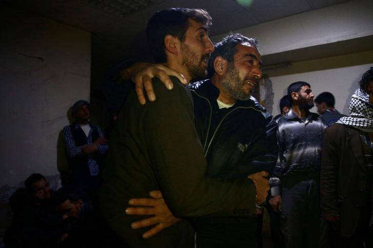 Men mourn the death of their relatives after airstrikes in the rebel held besieged Douma neighbourhood of Damascus, Syria April 3, 2017. REUTERS/Bassam Khabieh