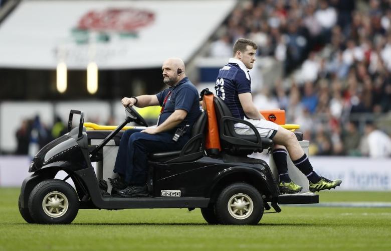 Britain Rugby Union - England v Scotland - Six Nations Championship - Twickenham Stadium, London - 11/3/17 Scotland's Mark Bennett goes off injured Reuters / Stefan Wermuth Livepic