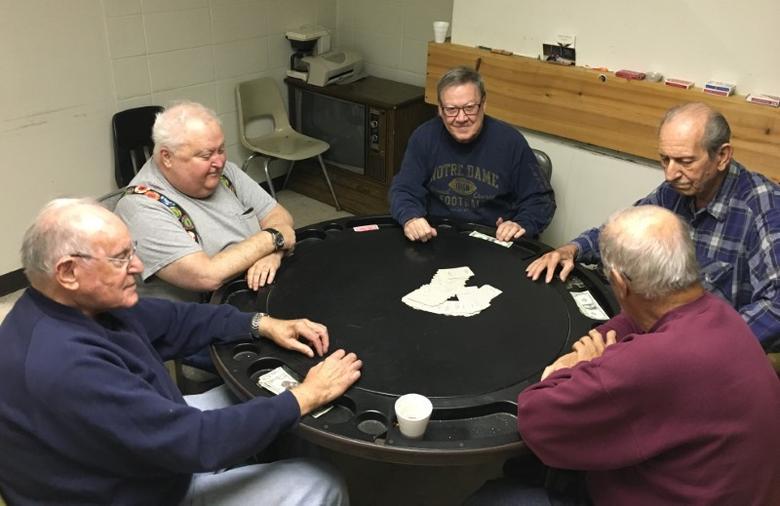 Retired steel workers Mike Pron (L to R) Jim McAndrew, Charlie Kelly, Joe Gonda and Ken Rayden play poker in a union hall in Bethlehem Pennsylvania, U.S., November 9, 2016. REUTERS/Peter Eisler