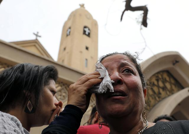A relative of one of the victims reacts after a church explosion killed at least 21 in Tanta, Egypt, April 9, 2017. REUTERS/Mohamed Abd El Ghany