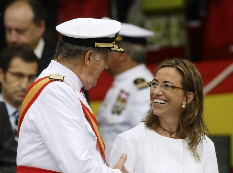 Spanish King Juan Carlos (L) talks to Spanish Minister of Defence Carme Chacon during celebrations for St. Carmen's day at Naval Military School in Marin, Northwestern Spain, July 16, 2009. REUTERS/Miguel Vidal/Files