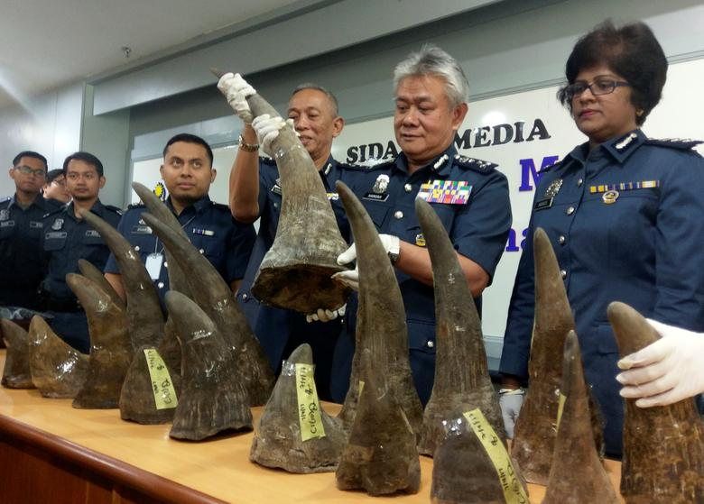 Kuala Lumpur International Airport (KLIA) customs director-general Hamzah Sundang (2nd R) poses with rhino horns that were seized on April 7 from Mozambique to Kuala Lumpur via Doha, during a news conference at the airport in Sepang, Malaysia April 10, 2017. REUTERS/Rozanna Latiff