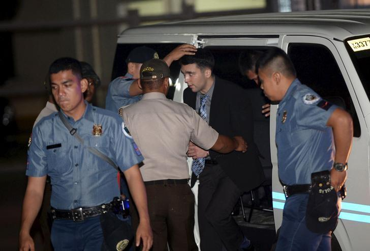 FILE PHOTO: Philippine Bureau of Corrections personnel escort U.S. Marine Lance Corporal Joseph Scott Pemberton (2nd R), after he was found guilty by trial court of killing Jennifer Laude, a transgender woman, upon arrival in a detention facility at Camp Aguinaldo in Quezon city, Metro Manila, December 1, 2015. REUTERS/Ted Aljibe/Pool