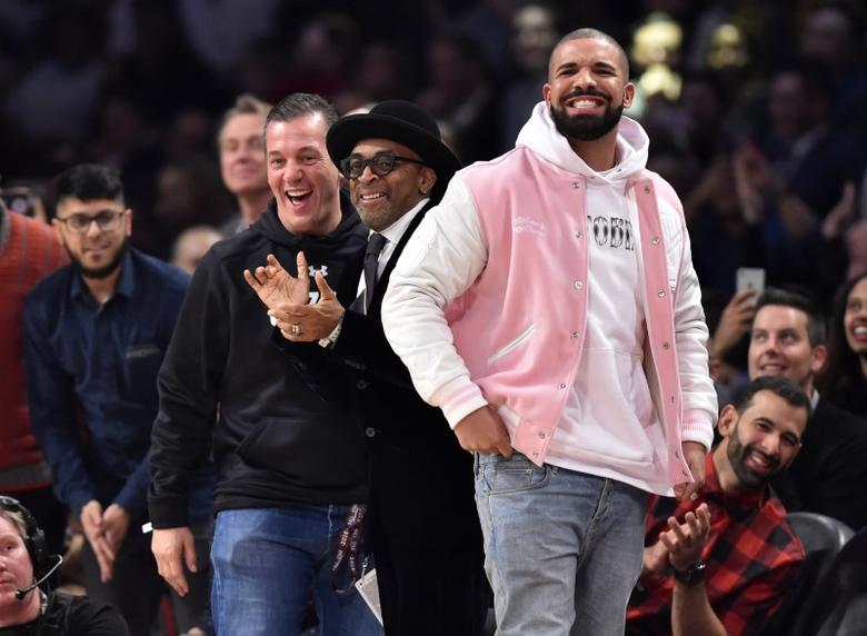 Feb 13, 2016; Toronto, Ontario, Canada; Recording artist Drake and film director Spike Lee react during the dunk contest during the NBA All Star Saturday Night at Air Canada Centre. Mandatory Credit: Bob Donnan-USA TODAY Sports  / Reuters Picture Supplied by Action Images