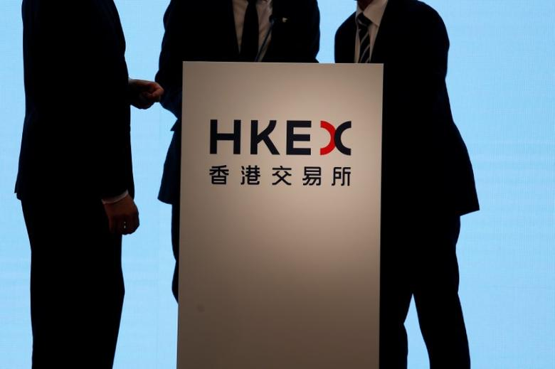 Staff prepare on a podium before an event celebrating the 16th anniversary of the Hong Kong Exchanges and Clearing Ltd (HKEX) in Hong Kong, China June 28, 2016.   REUTERS/Bobby Yip