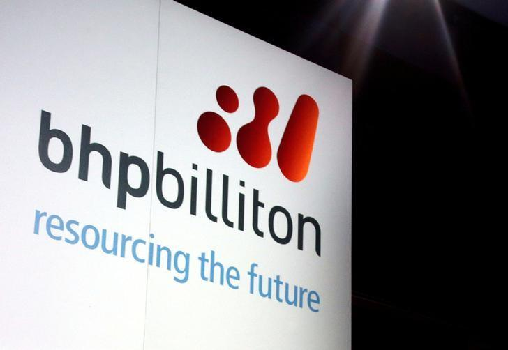 FILE PHOTO: A promotional sign adorns a stage at a BHP Billiton function in central Sydney August 20, 2013.     REUTERS/David Gray/File Photo