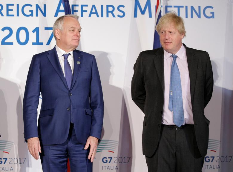 Britain's Foreign Secretary Boris Johnson (R) and France's Foreign Minister Jean-Marc Ayrault pose for a family photo during a G7 for foreign ministers in Lucca, Italy April 11, 2017. REUTERS/Max Rossi