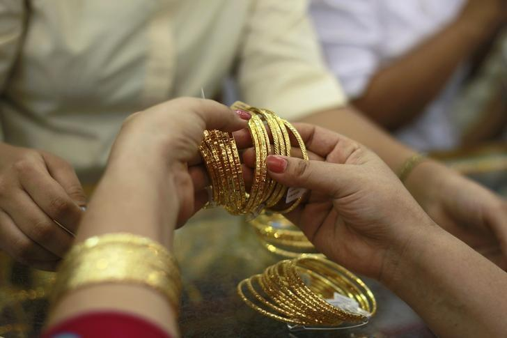 A customer looks at jewellery at a gold shop in Yangon April 23, 2013. REUTERS/Soe Zeya Tun