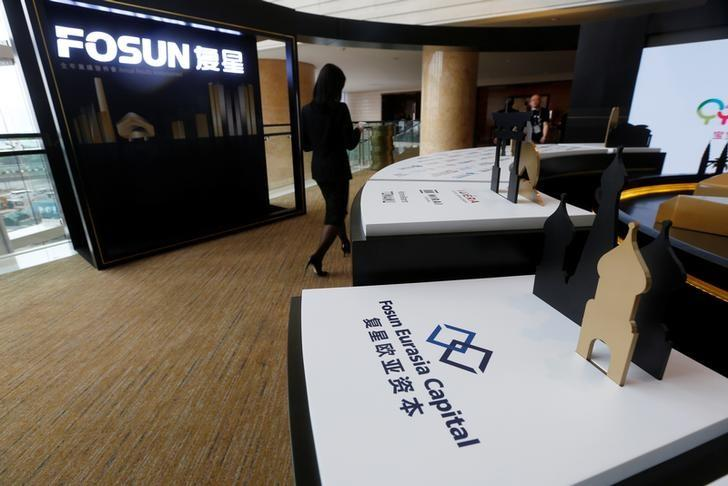 Fosun International Ltd services are displayed at a news conference in Hong Kong, China March 29, 2017.  REUTERS/Bobby Yip