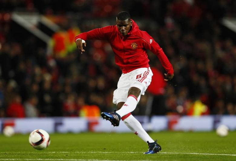 Britain Football Soccer - Manchester United v FC Rostov - Europa League Round of 16 Second Leg - Old Trafford, Manchester, England - 16/3/17 Manchester United's Paul Pogba warms up before the match Action Images via Reuters / Jason Cairnduff Livepic