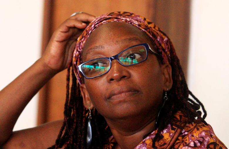FILE PHOTO: Ugandan prominent academic Stella Nyanzi stands in the dock at Buganda Road Court for criticising the wife of President Yoweri Museveni on social media, in Kampala, Uganda April 10, 2017. REUTERS/James Akena