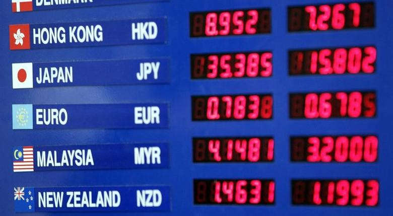 Currency exchange rates are shown at a money exchange site in New York July 11 , 2007.  REUTERS/Shannon Stapleton