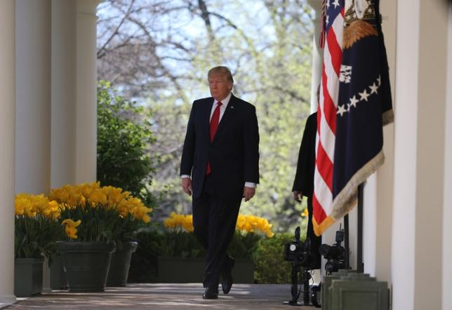 U.S. President Donald Trump arrives for a swearing in ceremony for new Supreme Court Associate Justice Neil Gorsuch in the Rose Garden of the White House in Washington, U.S., April 10, 2017. REUTERS/Carlos Barria