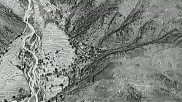 Still image taken from a video released by the U.S. Department of Defense on April 14, 2017 shows the moment before a MOAB, or ''mother of all bombs'', struck the Achin district of the eastern province of Nangarhar, Afghanistan, bordering Pakistan where U.S. officials said a network of tunnels and caves was being used by militants linked to Islamic State. U.S. Department of Defense/Handout via REUTERS ATTENTION EDITORS - THIS IMAGE WAS PROVIDED BY A THIRD PARTY. EDITORIAL USE ONLY.