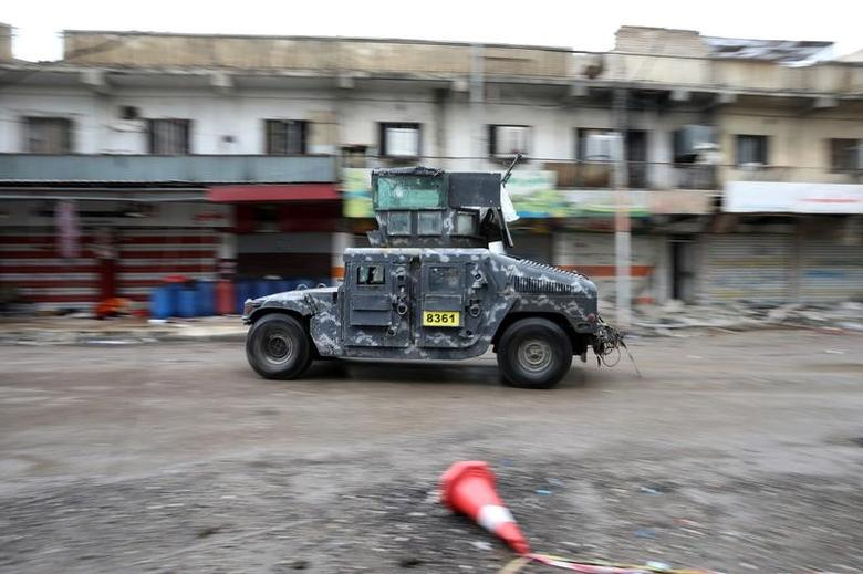 A vehicle of the Iraqi forces drives along a street controlled by the Iraqi Federal Police during combat with Islamic State in western Mosul, Iraq, April 14, 2017. REUTERS/Andres Martinez Casares