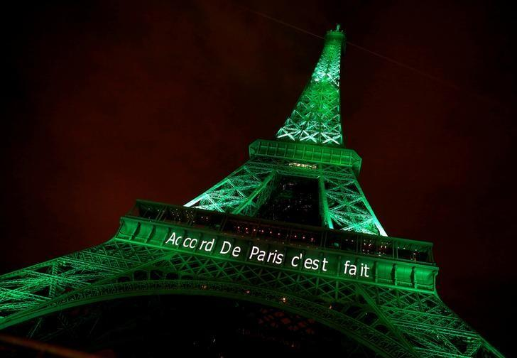 The Eiffel tower is illuminated in green with the words ''Paris Agreement is Done'', to celebrate the Paris U.N. COP21 Climate Change agreement in Paris, France, November 4, 2016. REUTERS/Jacky Naegelen/Files
