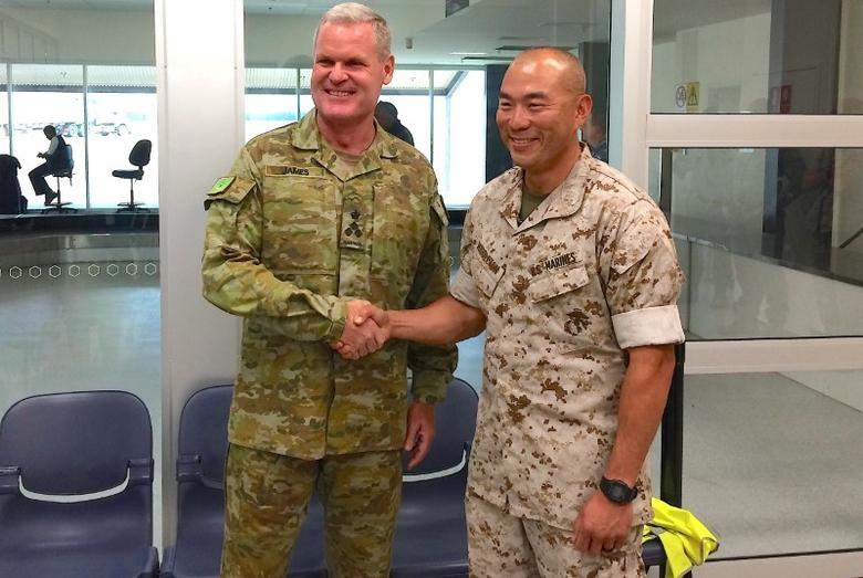 U.S. Marines commander Lieutenant Colonel Brian Middleton (R) shakes hands with Australian Army Brigadier Ken James after arriving for the sixth annual Marines' deployment at Darwin in northern Australia, April 18, 2017.    REUTERS/Tom Westbrook