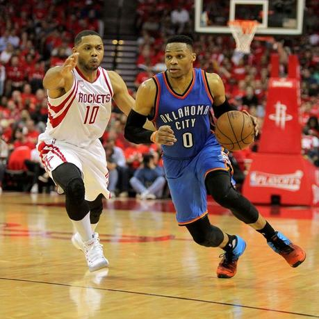 Apr 19, 2017; Oklahoma City Thunder guard Russell Westbrook (0) drives past Houston Rockets guard Eric Gordon (10) during the second quarter in game two of the first round of the 2017 NBA Playoffs at Toyota Center. Mandatory Credit: Erik Williams-USA TODAY Sports - RTS131PD