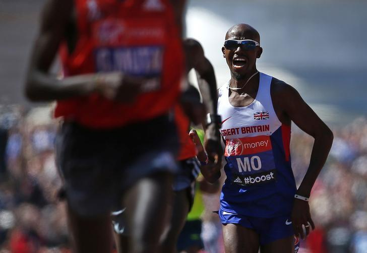 FILE PHOTO - Mo Farah of Britain sprints down The Mall before finishing in eighth position in the men's Elite London Marathon April 13, 2014. REUTERS/Eddie Keogh