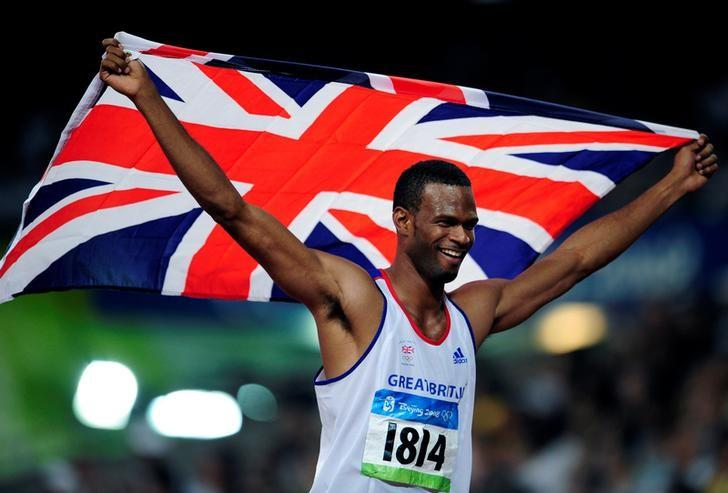 Germaine Mason of Britain celebrates after finishing second in the men's high jump athletics final during the Beijing 2008 Olympic Games at the National Stadium August 19, 2008.     REUTERS/Dylan Martinez/File Photo