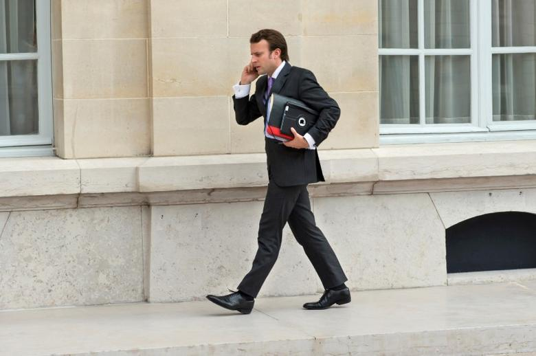 FILE PHOTO: French President's councillor Emmanuel Macron talks on a mobile phone as he arrives to attend a meeting at the OECD headquarters in Paris October 29, 2012.   REUTERS/Bertrand Langlois/Pool/File Photo