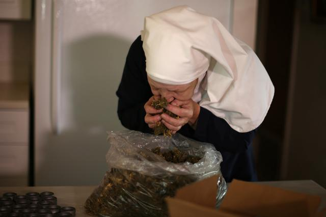 California ''weed nun'' Christine Meeusen, 57, who goes by the name Sister Kate, smells hemp in the kitchen at Sisters of the Valley near Merced, California, U.S., April 18, 2017. REUTERS/Lucy Nicholson
