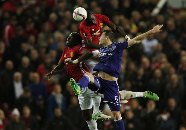 Britain Football Soccer - Manchester United v RSC Anderlecht - UEFA Europa League Quarter Final Second Leg - Old Trafford, Manchester, England - 20/4/17 Manchester United's Eric Bailly and Paul Pogba in action with Anderlecht's Uros Spajic  Reuters / Andrew Yates Livepic