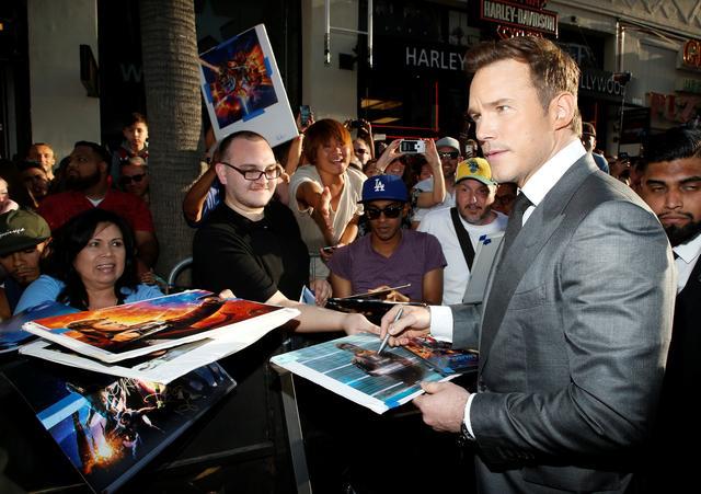 Actor Chris Pratt signs autographs. REUTERS/Danny Moloshok