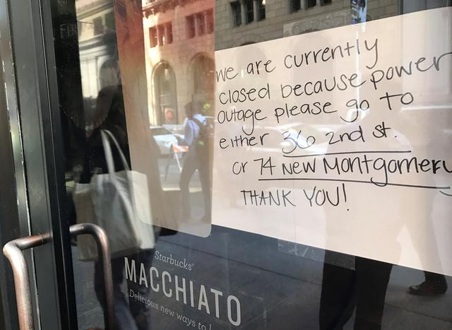 A sign on a Starbucks coffee shop informs customers that the facility is closed due to a power cut, in the financial district of San Francisco, California, U.S. April 21, 2017.  REUTERS/Alexandria Sage