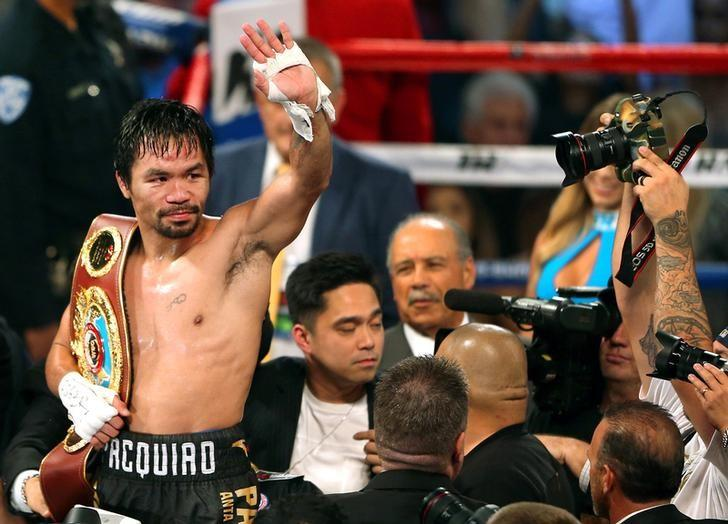 FILE PHOTO: Manny Pacquiao of the Philippines celebrates after defeating Jessie Vargas of Las Vegas to become WBO welterweight champion at the Thomas & Mack Center in Las Vegas, Nevada, U.S., November 5, 2016. REUTERS/Las Vegas Sun/L.E. Baskow/Files