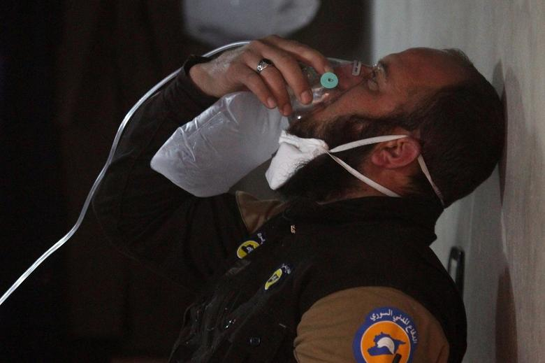 A civil defence member breathes through an oxygen mask, after what rescue workers described as a suspected gas attack in the town of Khan Sheikhoun in rebel-held IdlibREUTERS/Ammar Abdullah
