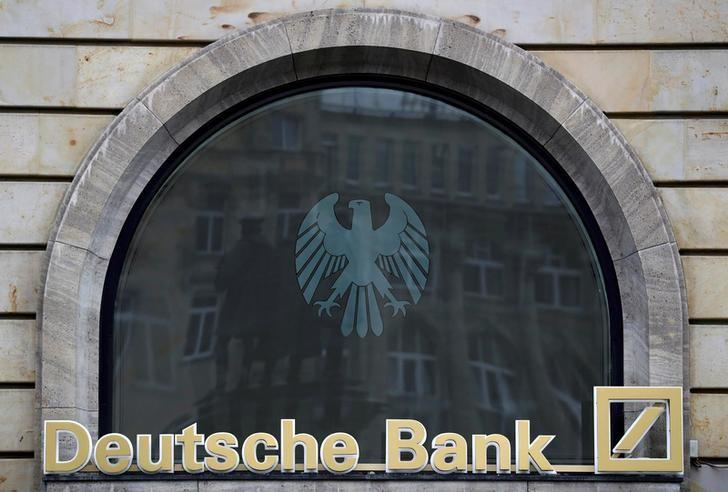 FILE PHOTO: The Deutsche Bank logo is pictured at a branch in Frankfurt, Germany, September 30, 2016. REUTERS/Kai Pfaffenbach/File Photo