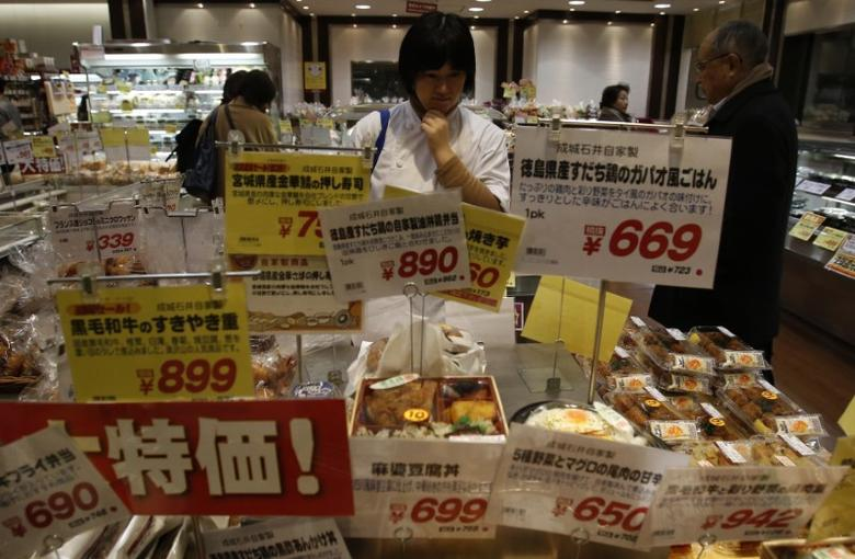 A shopper looks at food at a supermarket in Tokyo February 26, 2015. REUTERS/Yuya Shino