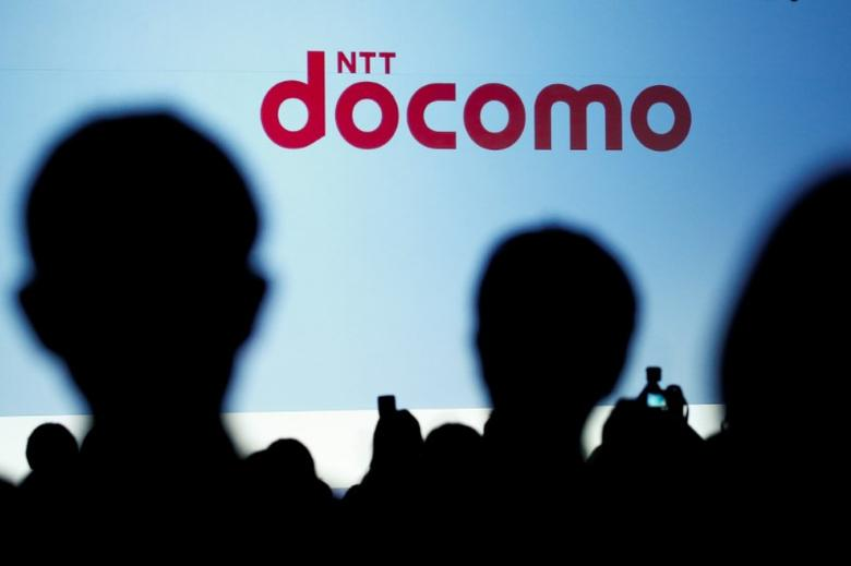 People attend a product unveiling event of the Japanese mobile communications company NTT Docomo in Tokyo, Japan, May 11, 2016. REUTERS/Thomas Peter