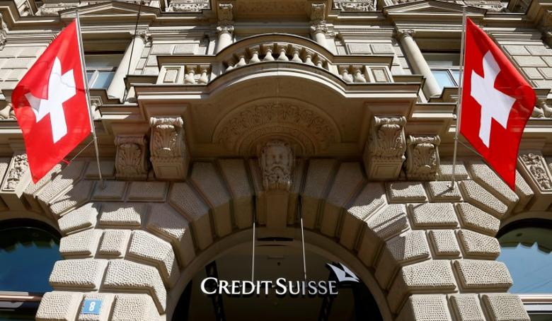 Switzerland's national flags fly beside the logo of Swiss bank Credit Suisse in Zurich, Switzerland April 24, 2017. REUTERS/Arnd Wiegmann