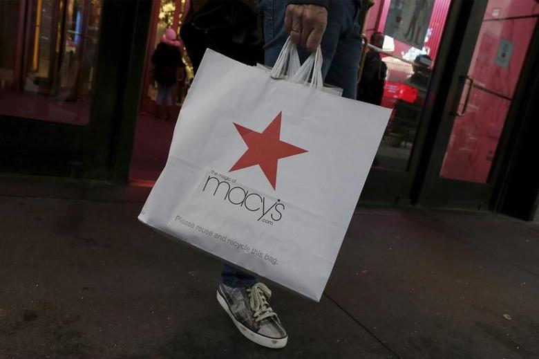 A customer exits the Macy's flagship department store in midtown Manhattan in New York City, November 11, 2015. REUTERS/Brendan McDermid