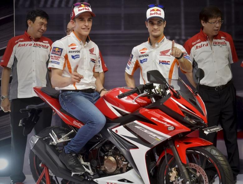 File Photo: MotoGP rider Marc Marquez (L) and Dani Pedrosa (R) pose during the launch of a new Honda CBR150R at the Sentul Circuit, Bogor, West Java, Indonesia on February 14, 2016 in this photo taken by Antara Foto.  REUTERS/Yudhi Mahatma/Antara Foto Picture Supplied by Action Images