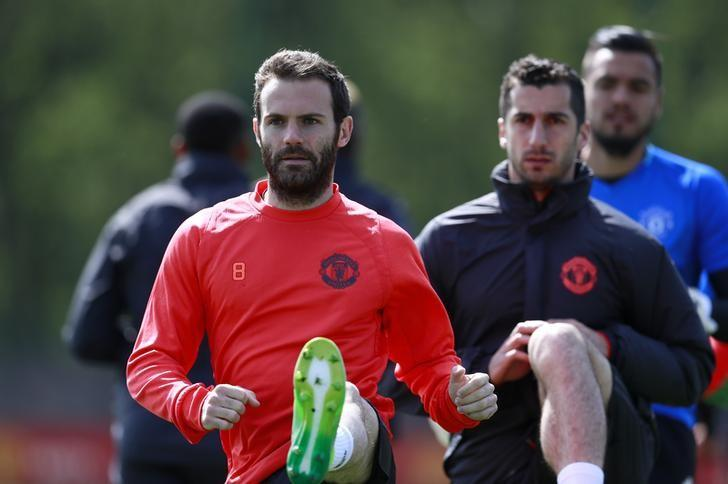 Britain Soccer Football - Manchester United Training - Manchester United Training Ground - 3/5/17 Manchester United's Juan Mata and Henrikh Mkhitaryan during training Action Images via Reuters / Jason Cairnduff Livepic