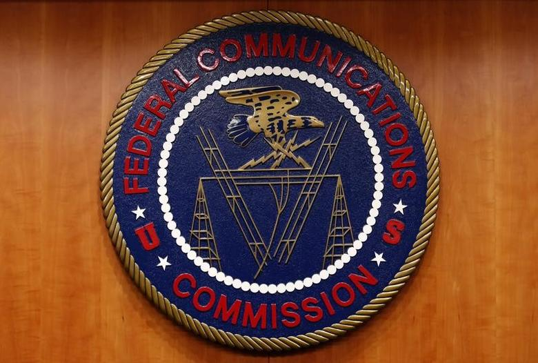 FILE PHOTO: The Federal Communications Commission (FCC) logo is seen before the FCC Net Neutrality hearing in Washington February 26, 2015. REUTERS/Yuri Gripas