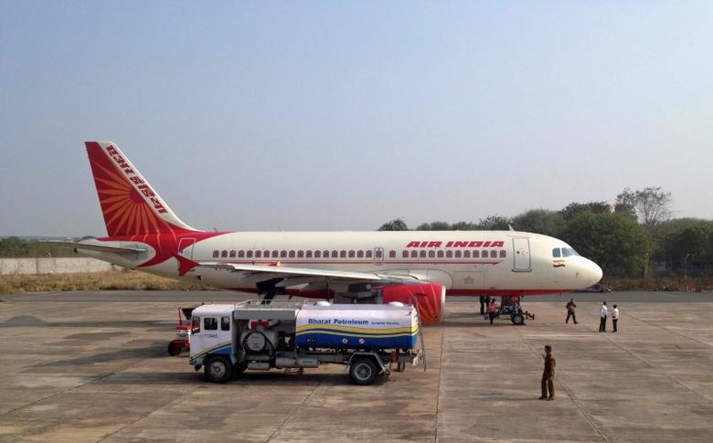FILE PHOTO: A Bharat Petroleum refuelling vehicle sits on the tarmac next to an Air India A320 aircraft as it refuels the plane with jet fuel in Gwalior, India, February 23, 2012. REUTERS/Vivek Prakash/File photo