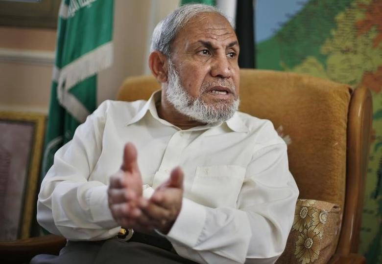 FILE PHOTO: Veteran Hamas strategist Mahmoud Al-Zahar gestures during an interview with Reuters at his house in Gaza City April 29, 2014.  REUTERS/Suhaib Salem