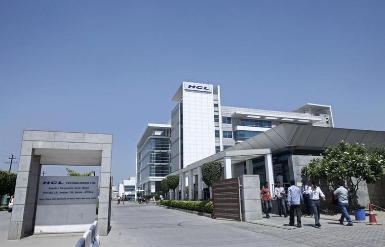 People walk in front of the HCL Technologies Ltd office at Noida, on the outskirts of New Delhi April 17, 2013. REUTERS/Mansi Thapliyal/Files