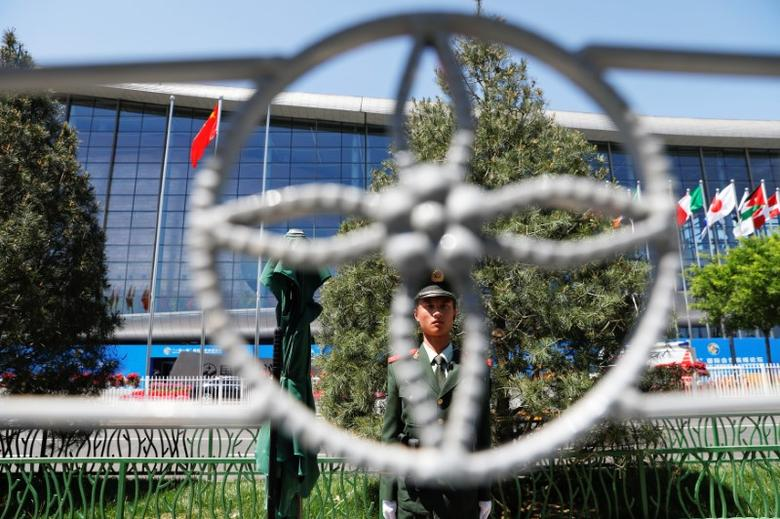 A paramilitary policemen secures the venue of the Belt and Road Forum in Beijing, China, May 14, 2017. REUTERS/Damir Sagolj